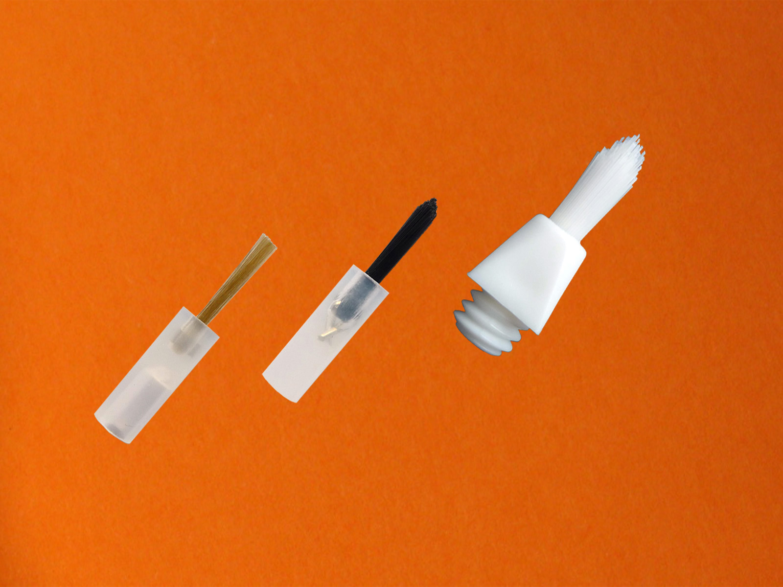 Brushes with different dimensions for dental holders.